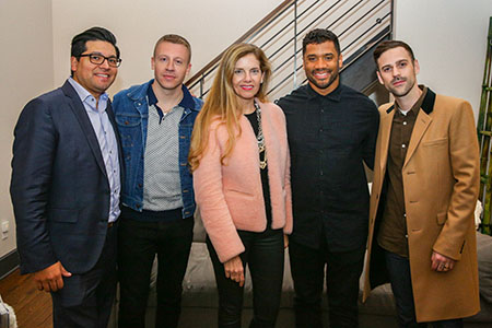 Larry Estrada, Macklemore, Chihuly, Russell Wilson and Ryan Lewis in May 2017 at an event announcing the Youth, Equity and Access to the Arts benefit concert. (Photo courtesy of the Why Not You Foundation)